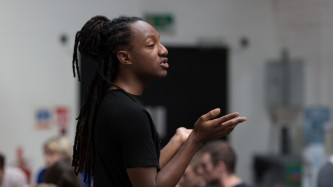 Joshua Allen speaks to participants at a workshop