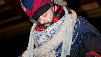 A man covered in woollen garments