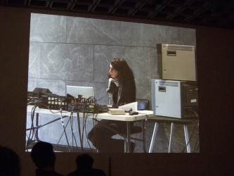 A screen show Ayreen Anastas at a table of equipment