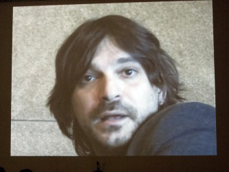 ON the screen is a close up of a person talking to camera