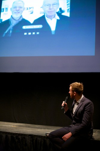 Barry Esson asking a question to the filmmakers on a screen on Skype