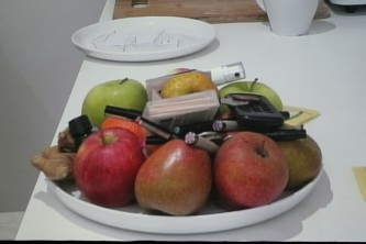 A shot of a screen showing a bowl of fruit