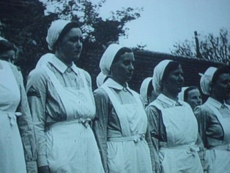 A shot of a screen showing a row of nurses
