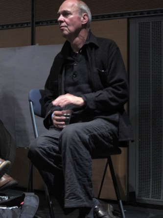 Lutz Becker sat on a chair during the discussion