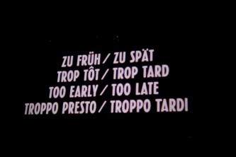Screen showing the title of the film Too Soon Too Late