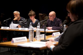 Four participants look towards their scripts