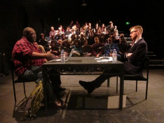 Fred Moten and Barry Esson sit across form each other as they discuss