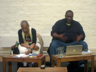 M. NourbSe Philips and Fred Moten sit next to each other during the talk
