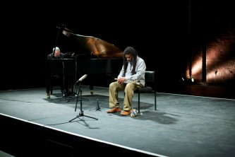 John Tilbury plays a piano whilst Wadada Leo Smith listens whilst sitting