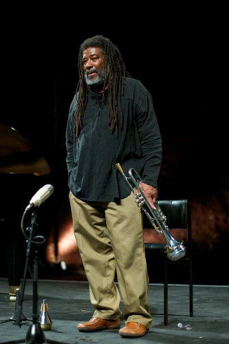 Wadada Leo Smith talks to the audience, trumpet by his side