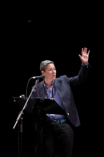 Jack Halberstam, in a suit, gesticulates, hand raised whilst delivering a talk