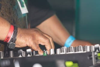 A close up for Vjuan Allure's hands as they use a mixer