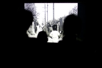 Silhouettes of audience heads as they watch Killer of Sheep on a screen