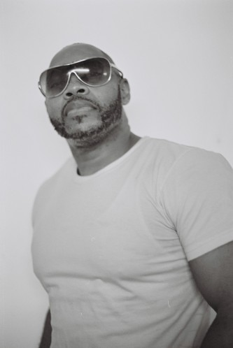Michael Roberson Garcon in white tshirt and shades poses for a portrait