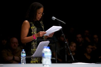 Saidiya Hartman reads from a paper at a microphone