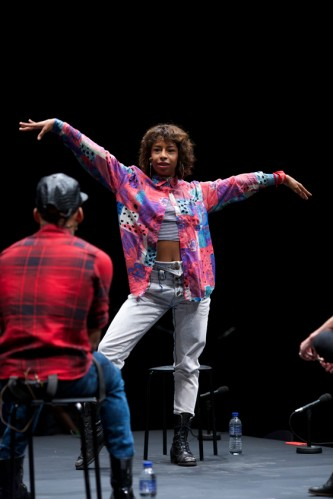 Kia Labeija dances on the stage as they smile at Pony Zion