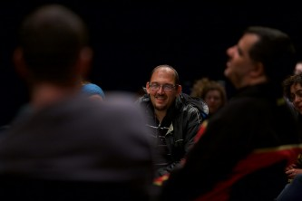 A member of Ueinzz smiles during the talk