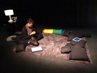 Valentina Desideri preparing in a dark space with cushions to do a reading