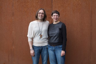 Terre and Laurence smile as they pose for a portrait