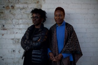Hortense Spillers and Denise Ferreria Da Silva smile at camera during a portrait