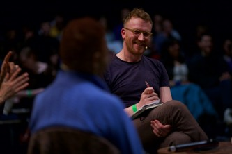 Barry Esson smiles at Hortense Spillers during the discussion