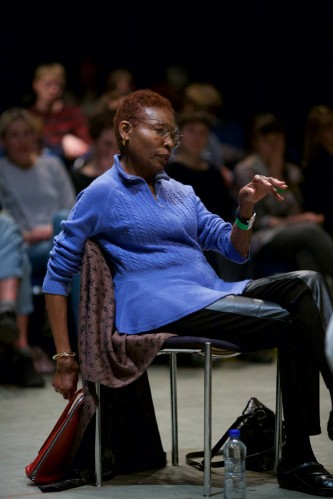 Hortense Spillers in blue and leather relaxes as she talks