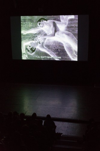 Projection of a film in front of an audience