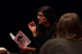 Nat Raha reading from a radical transfeminism booklet