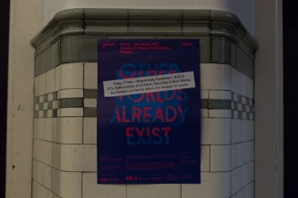 Photo of a poster for EPISODE 9 on a tiled wall