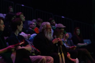 Samuel Delany talking from the audience during a discussion at EPISODE 9