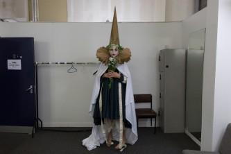Pre performance Sgàire Wood backstage in a pointed hat and mysterious garb
