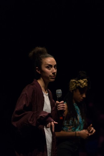 Claricia Kruithof seated talking into a microphone, frowning