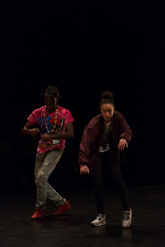 Storyboard P and Claricia Kruithof dancing on stage against a dark background