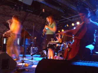 Current 93: people playing cello, recorder, accordion on stage at INSTAL 04