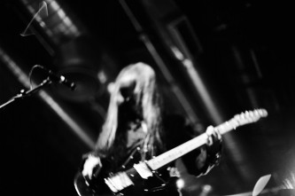 Keiji Haino playing an electric guitar with Vajra at INSTAL 04 Arches Glasgow