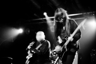 Keiji Haino and Kan Mikami playing guitars on stage at INSTAL 04