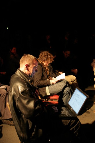 Achim Wollschied sits amongst the audience with a laptop