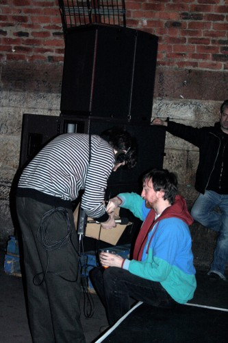 Jarrod Fowler offers a box of cd's to an audience member