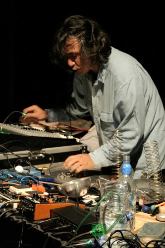 Kazuo Imai plays a table full of springs and objects