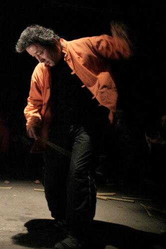Masami Tada in an orange top dances