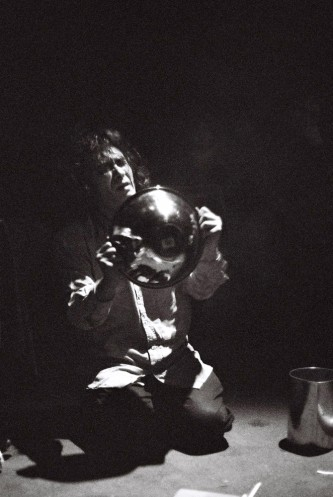 Kazuo Imai holding a bowl while kneeling on the floor at INSTAL 08
