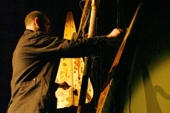 Rhodri holds some pieces of harp closer together