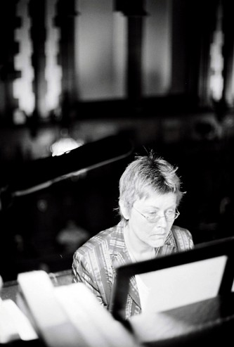 Eva Maria Houben looks at a score as she plays organ