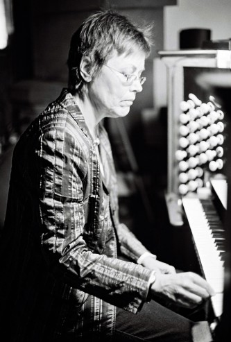 Eva Maria Houben looks down as she plays an organ