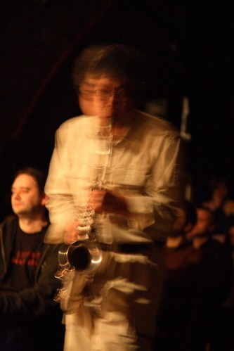 Tamio Shiraishi is a blurred figure as he plays a saxophone