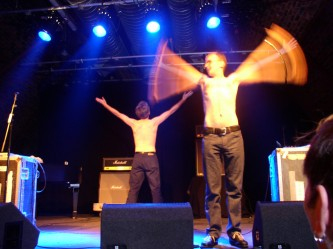 Whitehouse shirtless on stage in the arches waving their arms