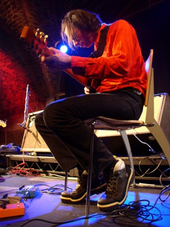 Alan licht playing an electric guitar