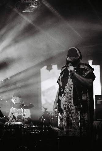 Masked figure in black and white with microphone