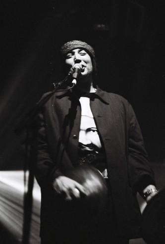 A man sings into a microphone