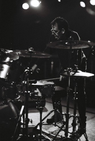 Tom Bruno standing at a drum kit